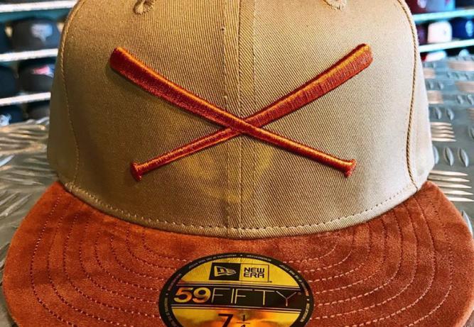 new-era-justfitteds-crossed-bats-logo-sude-sample